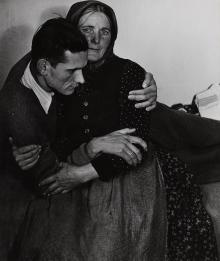 Woman supporting a sickly man at a displaced persons camp in Austria